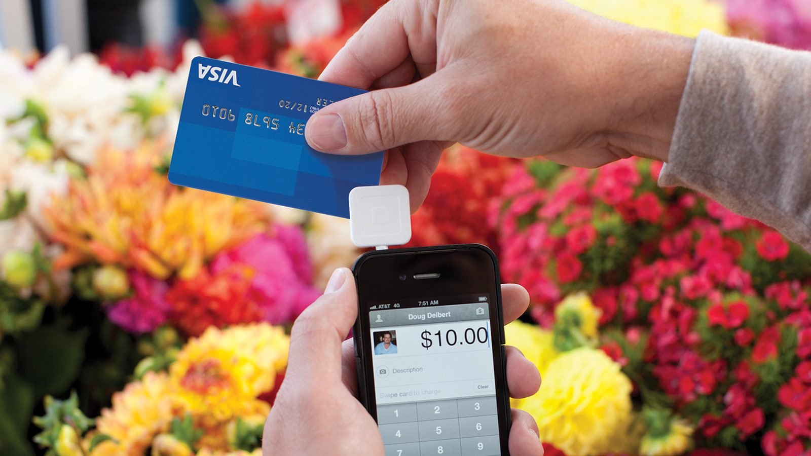 Florist completing a transaction with a Visa card
